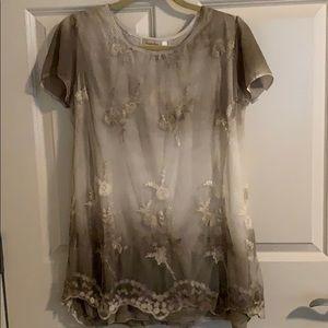 A khaki colored lace blouse
